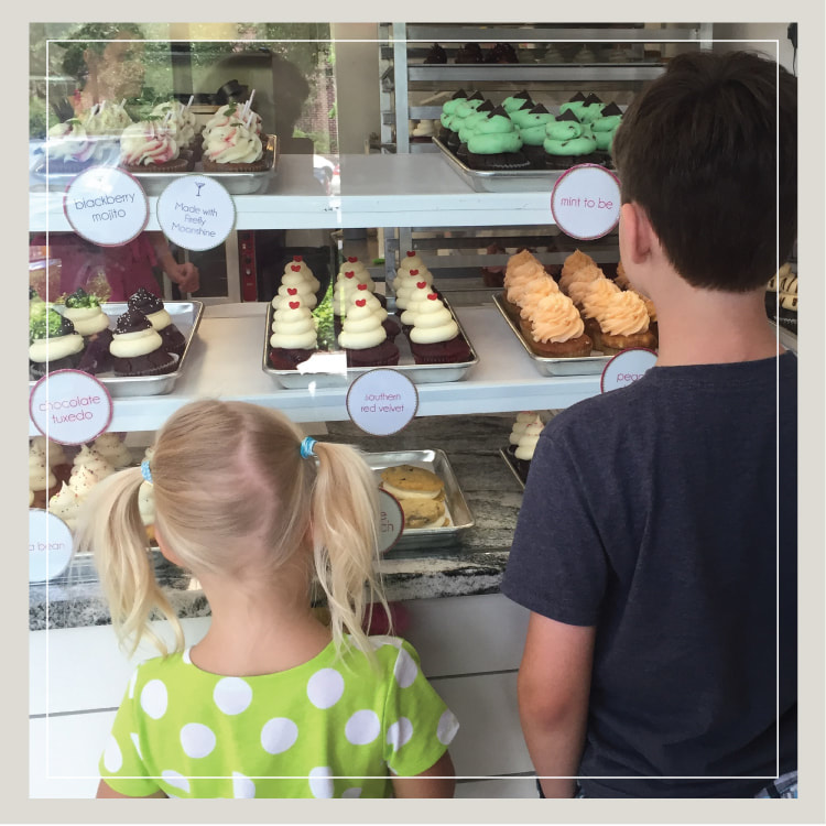 A Boy And Girl Drool Over The Cupcake Case At Birthday Party For