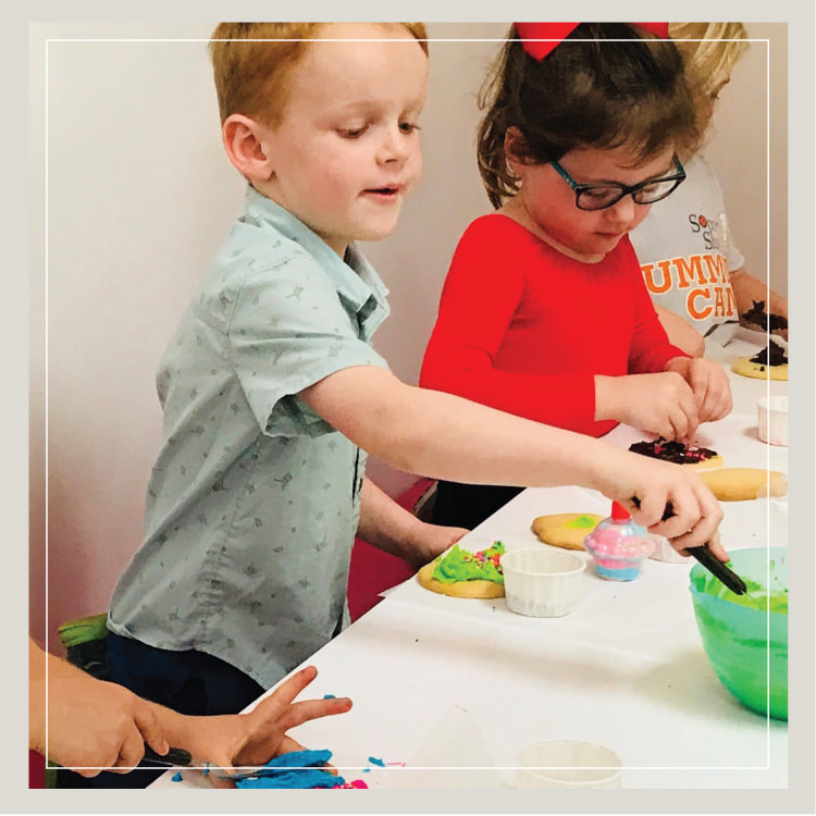 A Boy And Girl Decorating Cupcakes At Cupcake Birthday Party For Kids