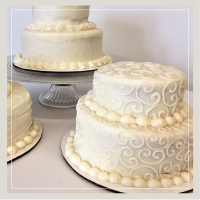 Beautiful cream-colored wedding cakes from Cupcake DownSouth in Charleston SC and Columbia SC